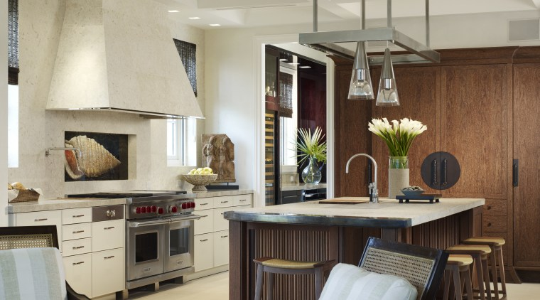 View of a kitchen featuring island, granite countertops, cabinetry, ceiling, countertop, cuisine classique, interior design, kitchen, room, gray, brown