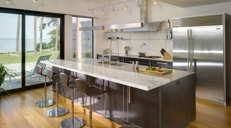 View of contemporary kitchen which features island, stainless countertop, interior design, kitchen, real estate, gray, brown