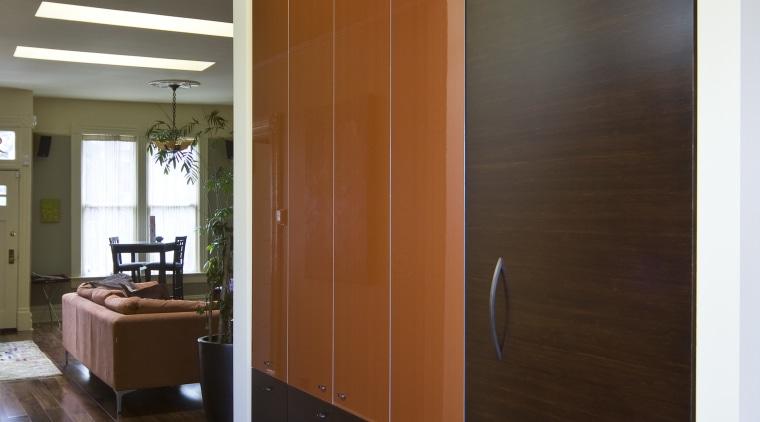 View of kitchen which features custom refrigerator cabinetry. cabinetry, ceiling, door, floor, flooring, hardwood, interior design, room, wall, wood, wood flooring, brown