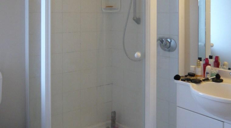 View of bathroom prior to renovations bathroom, door, plumbing fixture, room, shower, gray