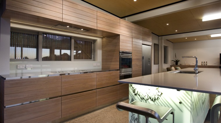 View of a kitchen which features an island interior design, kitchen, real estate, wood, brown
