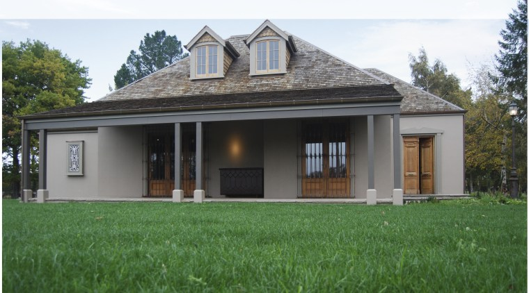 View of the renovated home by Architectural Designers cottage, elevation, estate, facade, farmhouse, grass, home, house, property, real estate, roof, villa, window, green, white