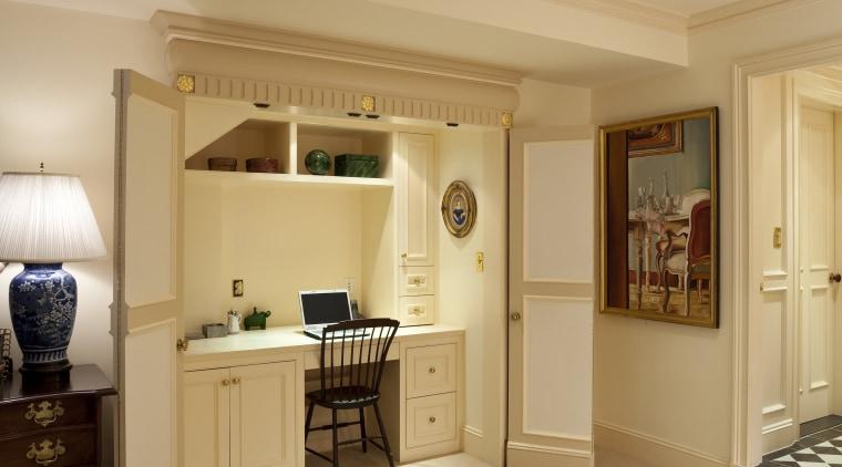View of desk area under a staircase. bedroom, ceiling, floor, flooring, home, interior design, lighting, living room, room, suite, wall, wood, wood flooring, orange, brown