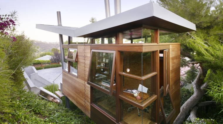 Exterior view of a contemporary tree house with home, house, outdoor structure, roof, shed, brown, teal