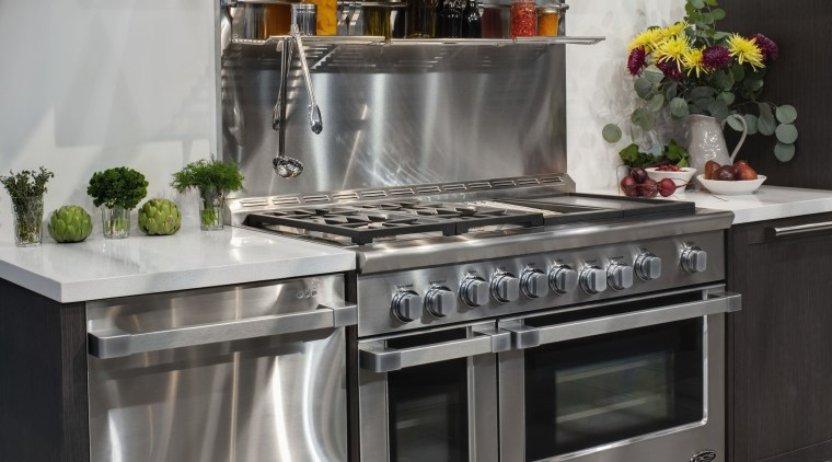 View of a kitchen which features DCS oven countertop, gas stove, home appliance, kitchen, kitchen appliance, kitchen stove, major appliance, oven, refrigerator, small appliance, gray, black