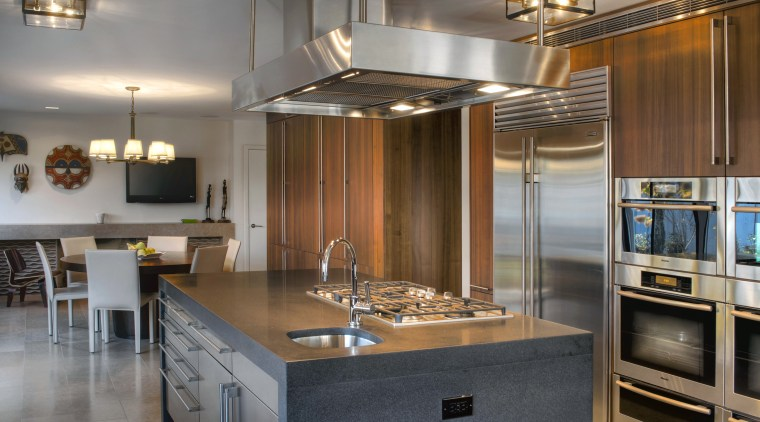 View of contemporary kitchen and dining area with cabinetry, countertop, cuisine classique, interior design, kitchen, real estate, room, gray, brown