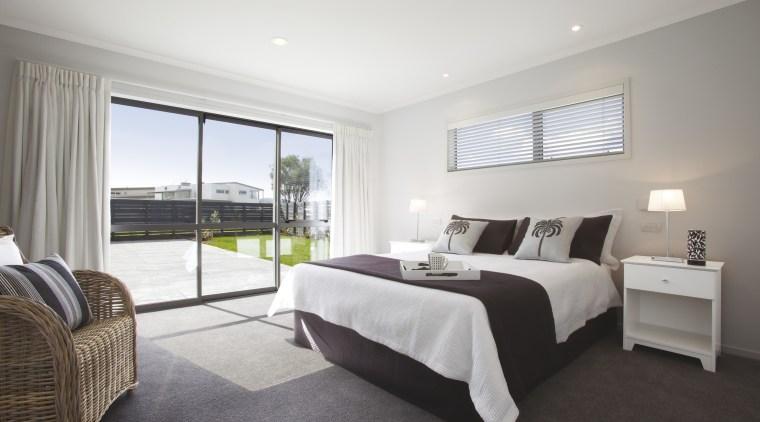 View of the master bedroom at Platinum Homes bed frame, bedroom, estate, floor, home, interior design, property, real estate, room, suite, window, gray
