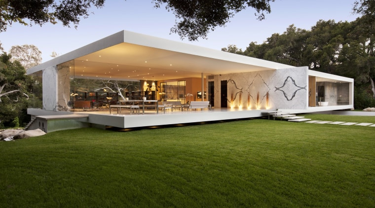Exterior view of a modern home with a architecture, backyard, estate, facade, grass, home, house, property, real estate, villa, brown