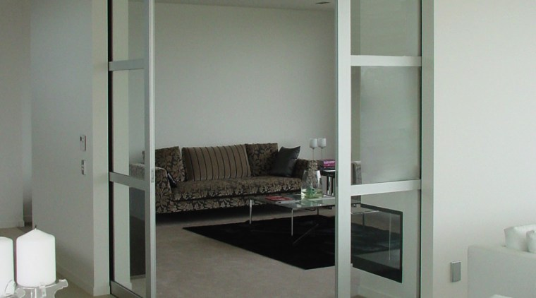 Interior view of an apartment which features a architecture, door, floor, glass, house, interior design, window, gray