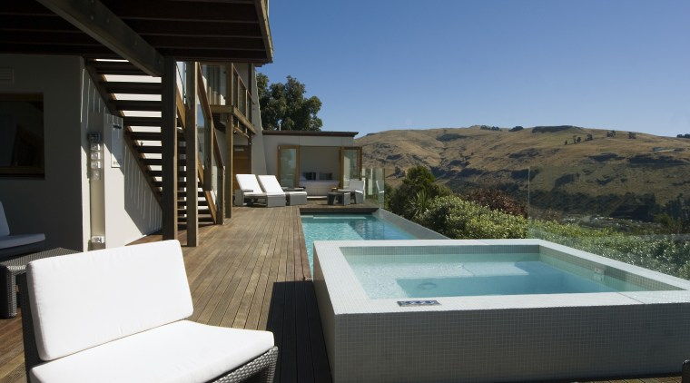View of pool and spa area with wooden estate, home, house, property, real estate, resort, swimming pool, villa, black