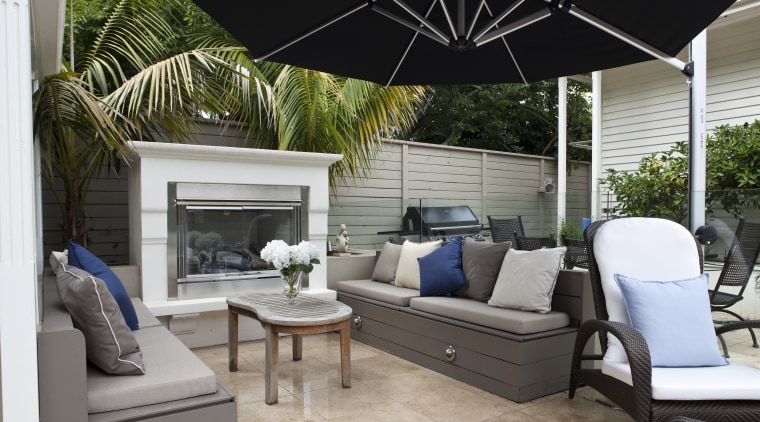 View of outdoor area with pool, paving, fountain, backyard, furniture, home, interior design, living room, outdoor structure, patio, property, real estate, gray, black