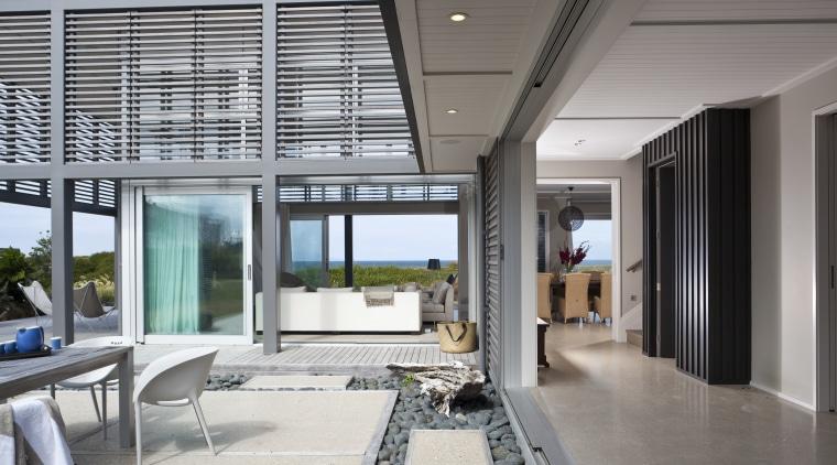 Contemporary beach house. Open-plan living daylighting, house, interior design, real estate, window, gray