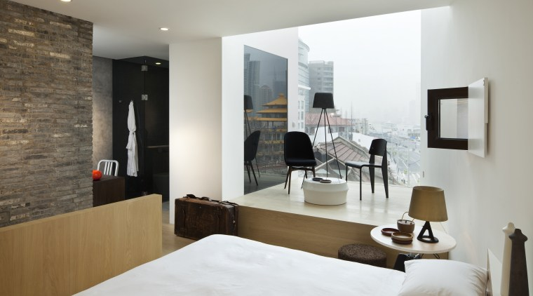 View of a contemporary boutique hotel in Shanghai. architecture, bed frame, bedroom, floor, furniture, interior design, living room, property, room, suite, wall, gray, white