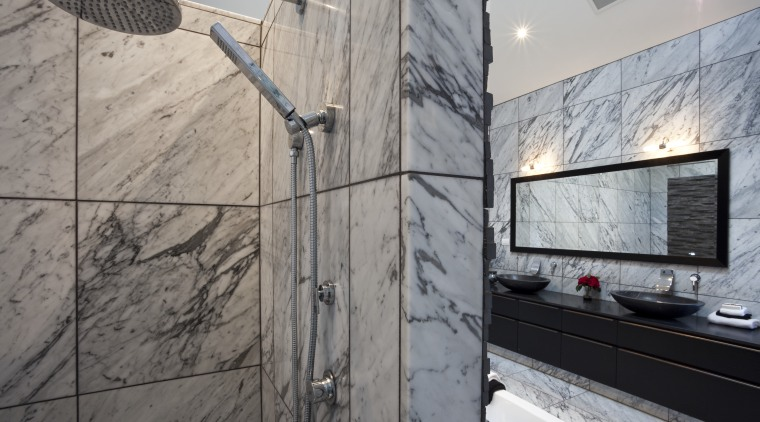 View of bedroom and bathroom with grey, black property, wall, gray