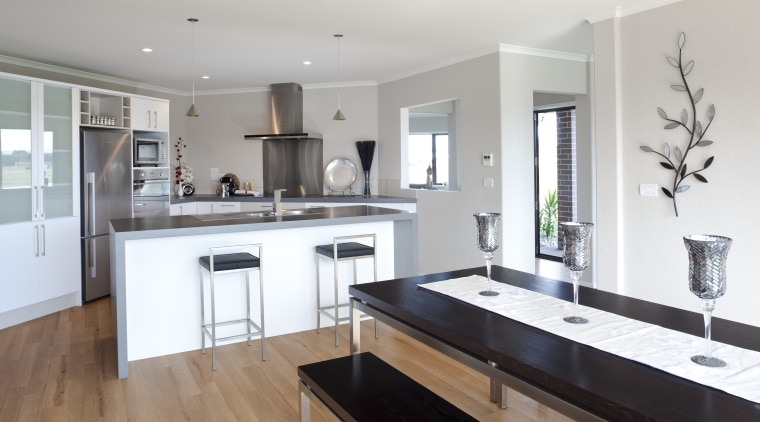 View of Platinum Homes show home with solid cabinetry, countertop, cuisine classique, floor, flooring, interior design, kitchen, property, real estate, room, gray