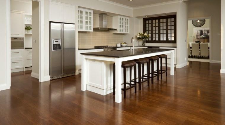 View of kitchen with wooden flooring, dark benchtops cabinetry, countertop, cuisine classique, floor, flooring, hardwood, interior design, kitchen, laminate flooring, room, wood, wood flooring, brown, gray