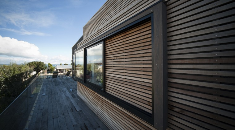 View of the Lite-House on Waiheke Island, a architecture, building, daylighting, facade, home, house, property, real estate, residential area, siding, sky, window, wood, black