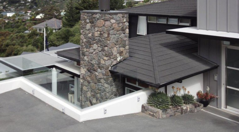 View of DJ Hewitt house built on a architecture, facade, house, outdoor structure, property, real estate, roof, siding, gray