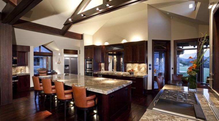 View of contemporary kitchen with dark wooden flooring, countertop, dining room, interior design, kitchen, real estate, black