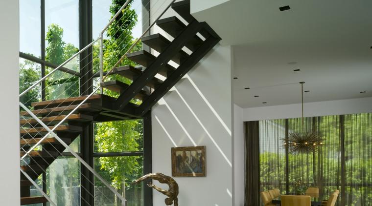 VIew of staircase. architecture, condominium, daylighting, handrail, home, house, interior design, lobby, stairs, gray