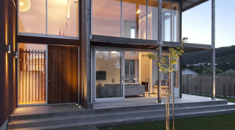 Exterior vIew of contemporary home. architecture, building, facade, home, house, real estate, residential area, window, black
