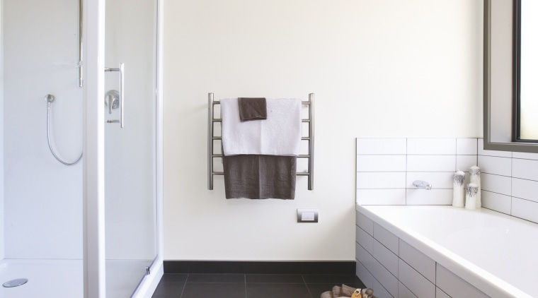 View of bathroom with dark tiles in a architecture, bathroom, bathroom accessory, bathroom cabinet, daylighting, floor, home, house, interior design, plumbing fixture, product design, room, white