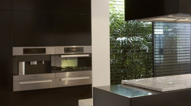 The kitchen designed by Michael Kilkeary of Embark, architecture, cabinetry, countertop, furniture, interior design, kitchen, black
