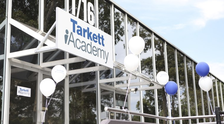 View of the Tarkett Academy building, structure, white, black