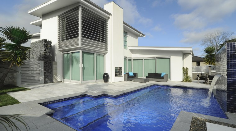 A new pool, by Mayfair pools, featuring a architecture, elevation, estate, facade, home, house, property, real estate, swimming pool, villa, window, gray