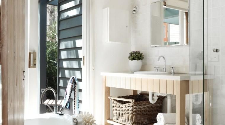 This house was renovated by Connor & Solomon bathroom, bathroom accessory, bathroom cabinet, floor, home, interior design, room, white