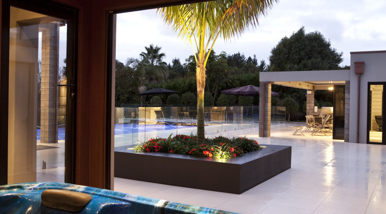 This home was designed by Thomas Errington of estate, home, house, interior design, property, real estate, resort, room, swimming pool, window, red