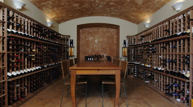 This house was designed by Mark Wilson of institution, library, liquor store, public library, wine cellar, winery, brown