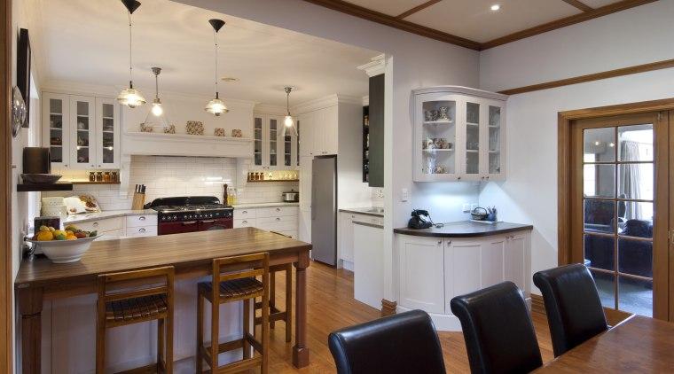 This kitchen was designed by Debra DeLorenzo of countertop, cuisine classique, interior design, kitchen, real estate, room, gray