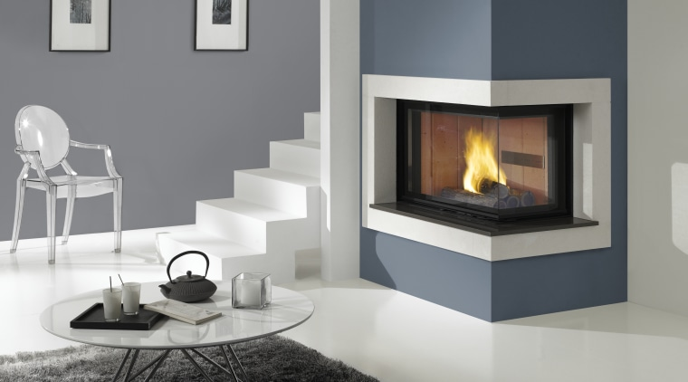 This frieplace was designed and supplied by Cheminees fireplace, furniture, hearth, heat, home appliance, interior design, living room, product design, wood burning stove, gray