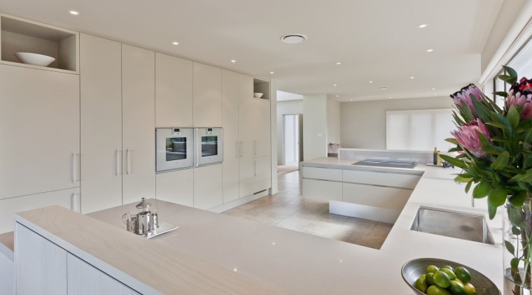 View of light coloured contemporary kitchen with vase countertop, interior design, kitchen, property, real estate, room, gray