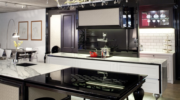 View of contemporary kitchen with lighting feature, black countertop, furniture, interior design, kitchen, table, gray