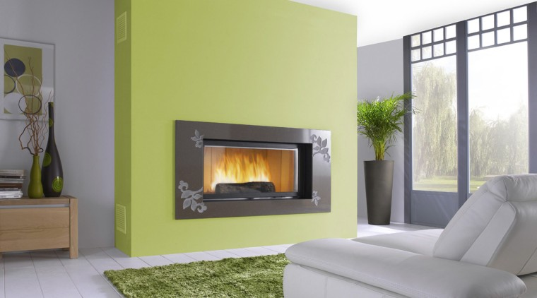 View of fireplace on green feature wall. fireplace, hearth, home, interior design, living room, wood burning stove, gray