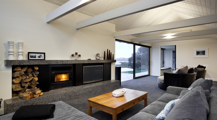 View of contemporary lounge with grey couch and architecture, ceiling, hearth, home, house, interior design, living room, property, real estate, room, gray