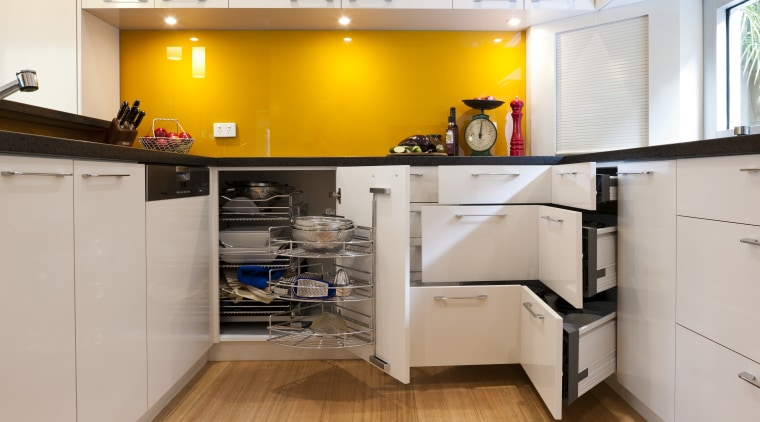 View of contemporary kitchen with yellow splashback and cabinetry, countertop, cuisine classique, floor, interior design, kitchen, room, gray