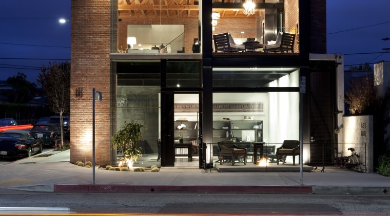 Exterior night shot of contemporary building. architecture, building, commercial building, evening, facade, home, house, mixed use, night, real estate, reflection, residential area, sky, black, blue