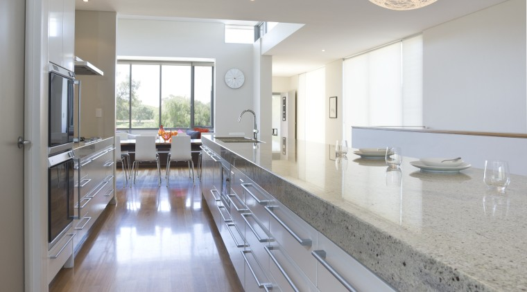 This 12ft-long island features a Bianco Romano granite architecture, ceiling, countertop, daylighting, floor, flooring, hardwood, home, house, interior design, kitchen, laminate flooring, real estate, room, wood, wood flooring, gray