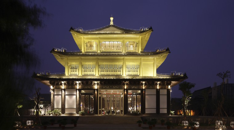 View of exterior at night. architecture, building, chinese architecture, classical architecture, evening, facade, landmark, lighting, night, sky, temple, tourist attraction, blue, black