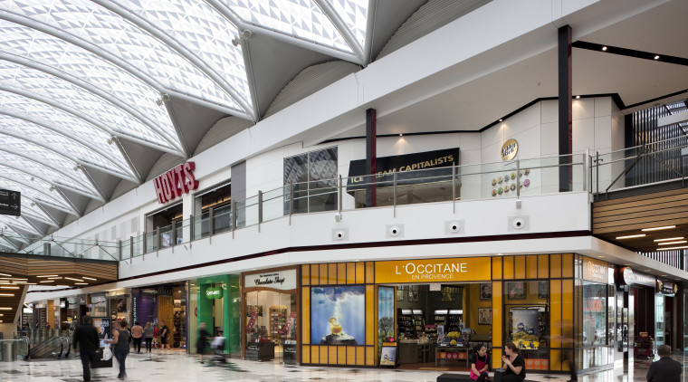 View of interior of mall. building, mixed use, outlet store, retail, shopping mall, white