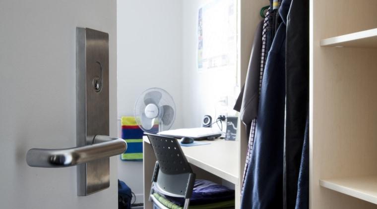 View of door handle. furniture, interior design, office, product design, room, shelf, gray