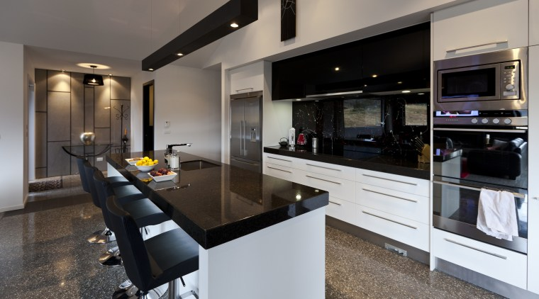 Kitchen with black benchtop and splashback, white cabinetry countertop, cuisine classique, interior design, kitchen, real estate, gray, black