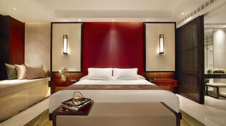 Bedroom with white bed and red feature wall. bed frame, bedroom, ceiling, hotel, interior design, room, suite, wall, orange