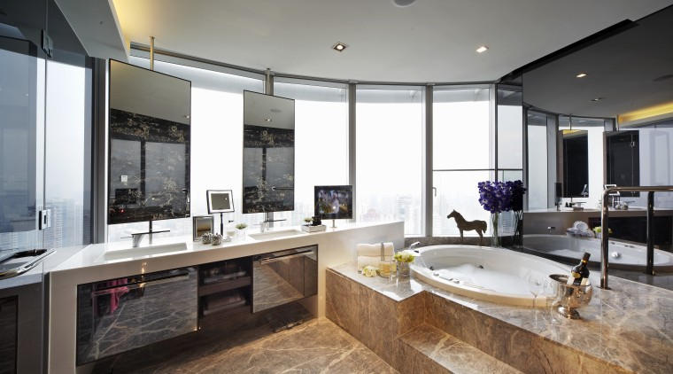 View of the bathroom.  The tiling is countertop, estate, interior design, kitchen, real estate, room, gray