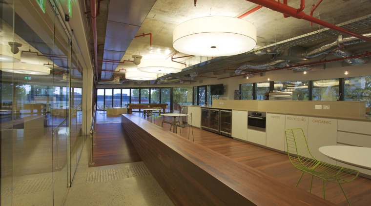 Interior with long wooden divider and exposed red interior design, leisure centre, brown