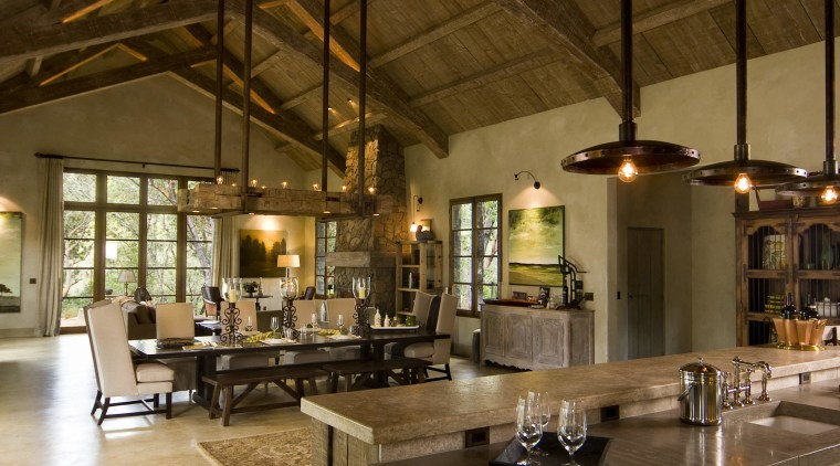 Rustic house modelled on French barn. Interiors feature beam, ceiling, countertop, interior design, kitchen, brown