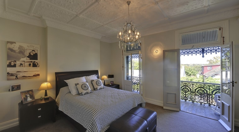 Bedroom with deck. architecture, bedroom, ceiling, estate, home, interior design, property, real estate, room, window, gray, brown